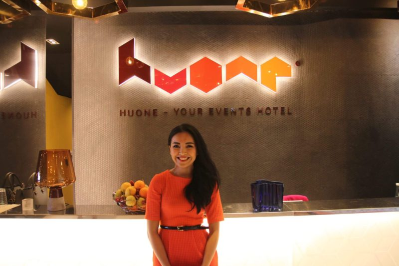 The Founder of Huone posing in front of Huone Singapore